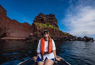 Woman on a panga ride in the Galapagos Islands