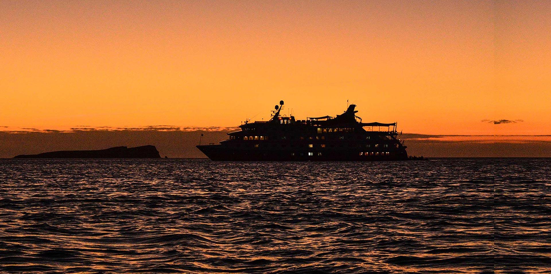 Santa Cruz II sailing in Galapagos at sunset