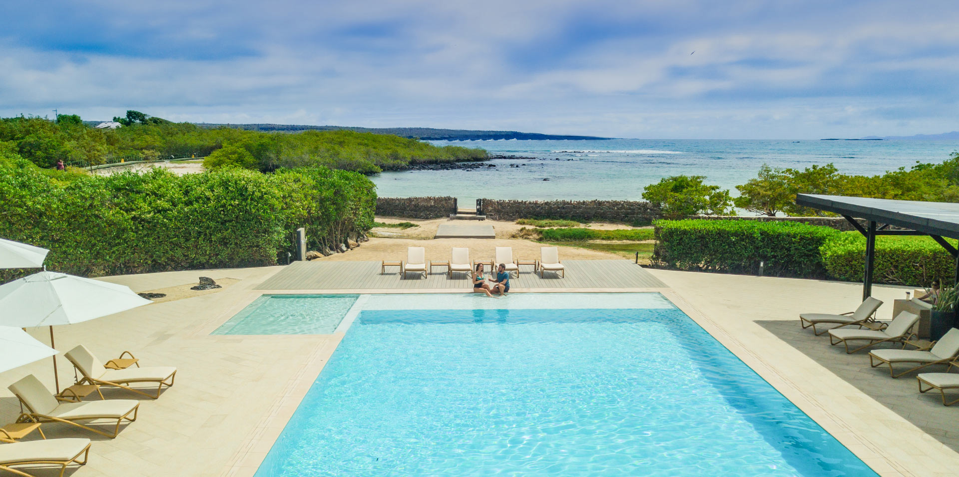 Finch Bay Galapagos Hotel pool and beach entrance