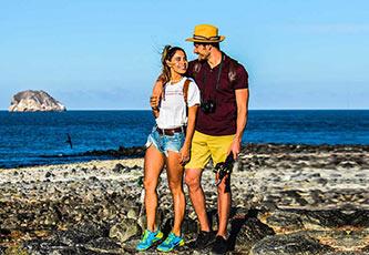 Couple walking in North Seymour Island, Galapagos