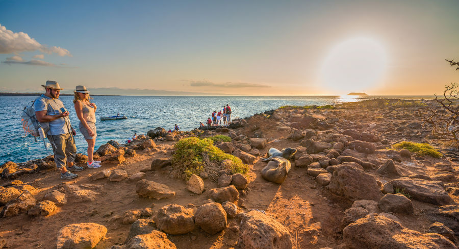 Couple hiking in the Galapagos National Park during sunset