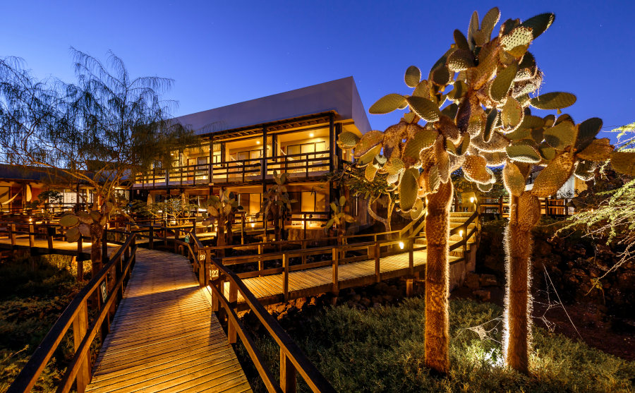 Lights come on as night falls around Finch Bay Galapagos Hotel