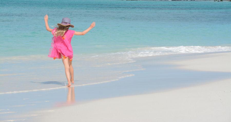 Girl having a fin time in the seaside, Galapagos