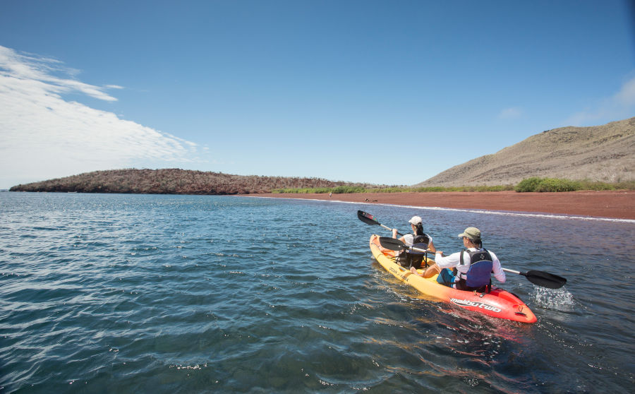 Visistors explore the coast ot Rabida on a Kayak in the Galapagos