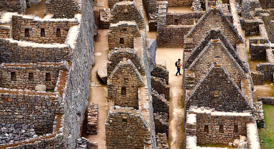 Tourist walking through the Machu Picchu Citadel