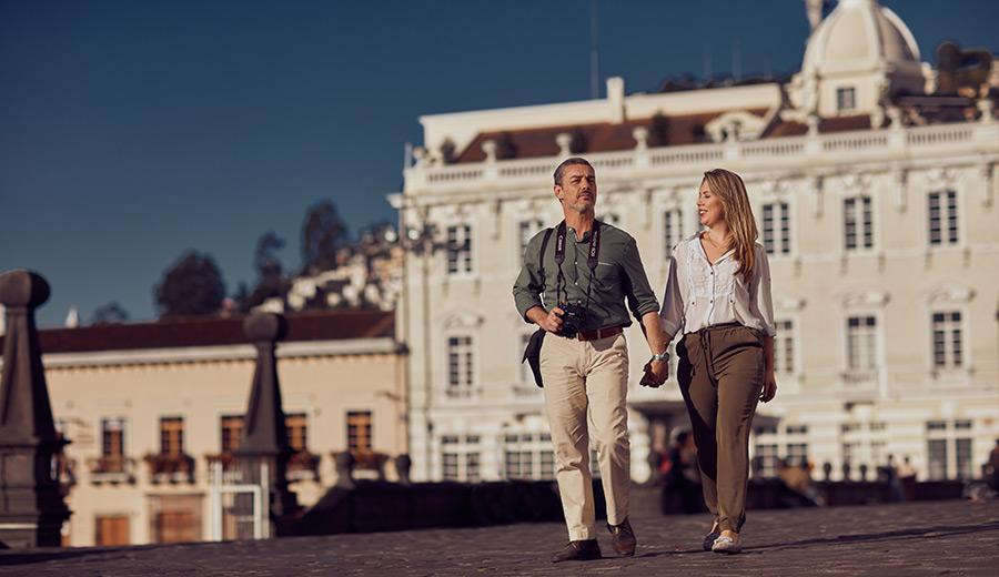 Couple walking on San Francisco Plaza in Quito, Ecuador