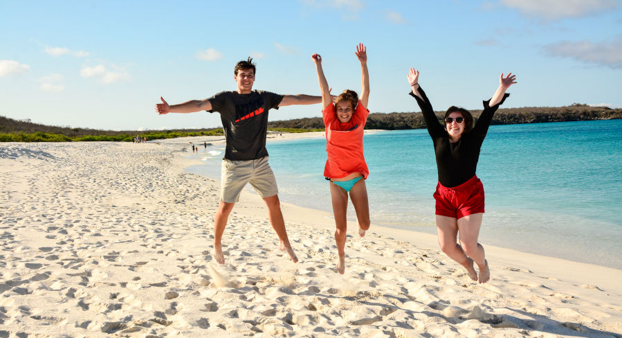 Tourists enjoying themselves on a beach in the Galapagos