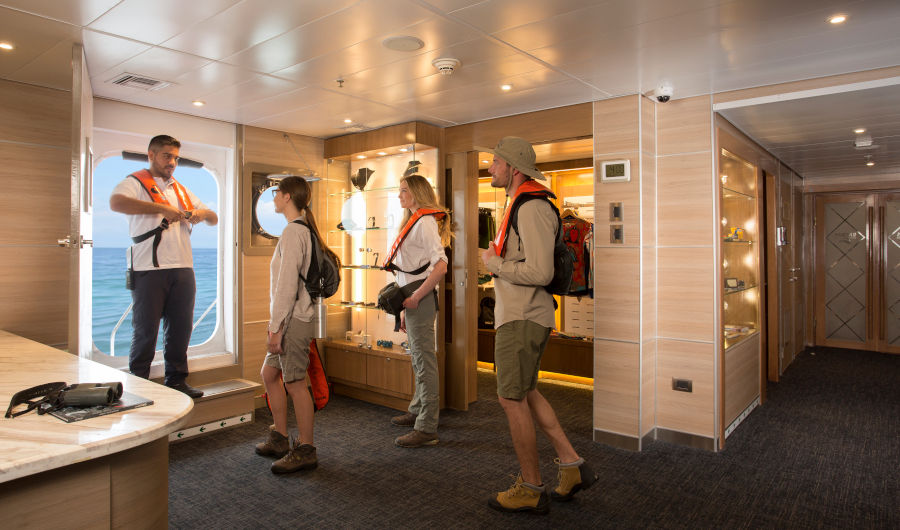 Visitors chime in on safety instructions prior to an expedition into the Galapagos Islands