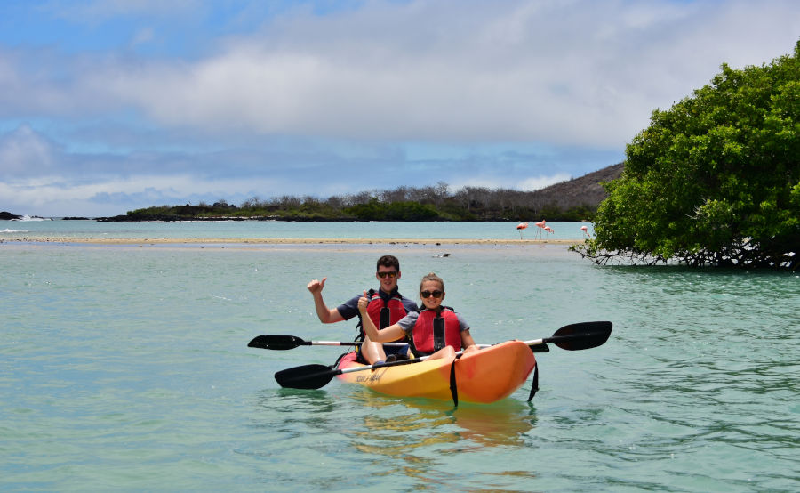 Couple rides around Post Office Bay on a Kayak in the Galapagos