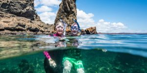 Senior travelers snorkeling in the Galapagos Islands
