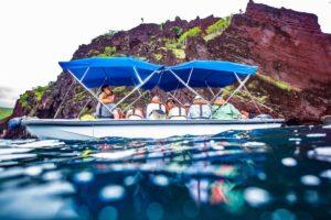 Glass bottom boat ride in Bucaneer Cove, Santiago Island