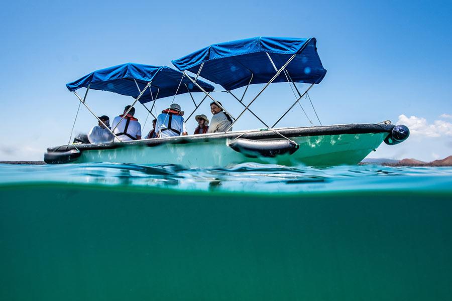 Glass-bottom boat ride sailing in Bartolome Island, Galapagos